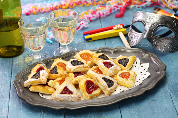 homemade hamantaschen cookies,noise maker and mask - Stock Photo - Images