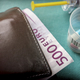 Wallet with dollar next to medicines, concept of copayment health - PhotoDune Item for Sale