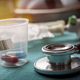 Stethoscope along with doses of medicine in a hospital, conceptual image - PhotoDune Item for Sale
