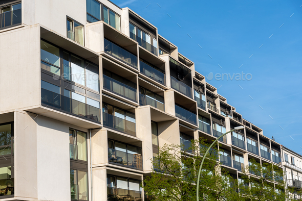 Facade of a modern housing construction with a lot of balconies - Stock Photo - Images