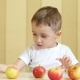 The Child Eats and Plays with Red and Green Apples - VideoHive Item for Sale