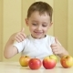 The Child Eats and Plays with Red and Green Apples, Sits at the Table and Shows the Thumb of - VideoHive Item for Sale