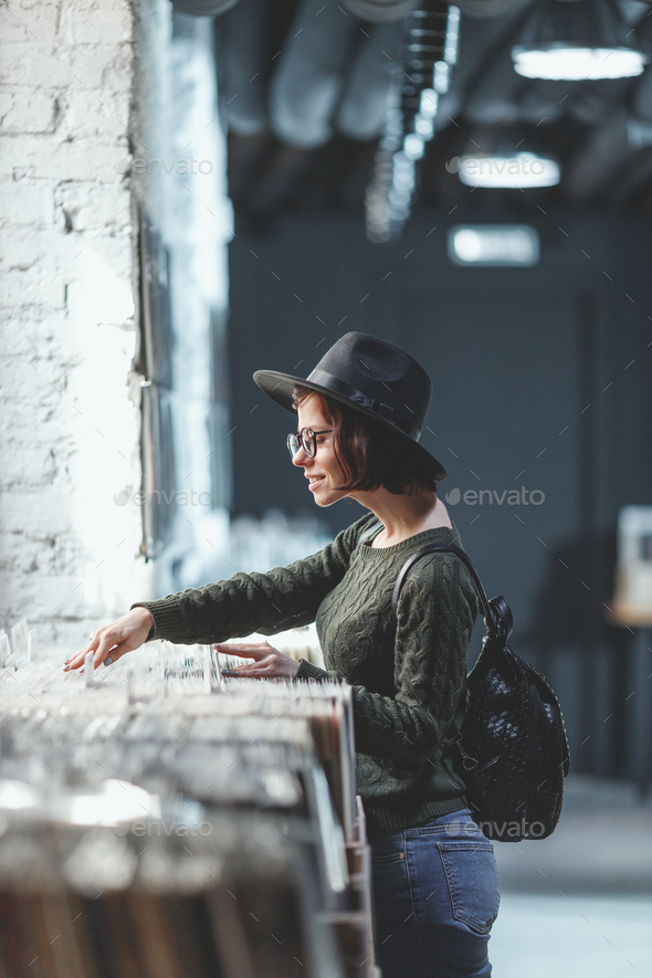 Young girl browsing records in a store - Stock Photo - Images
