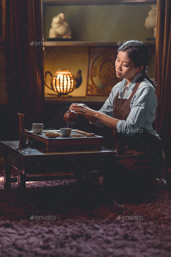Young tea master in the room - Stock Photo - Images