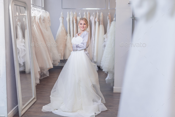 Smiling young girl with a wedding dress - Stock Photo - Images