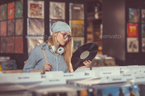 Young girl in a vinyl record store - Stock Photo - Images