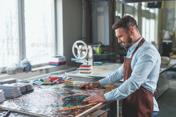Young man with mosaic in studio - Stock Photo - Images