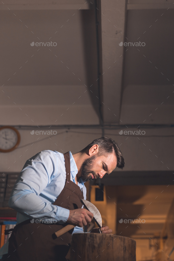 Young man in workshop - Stock Photo - Images