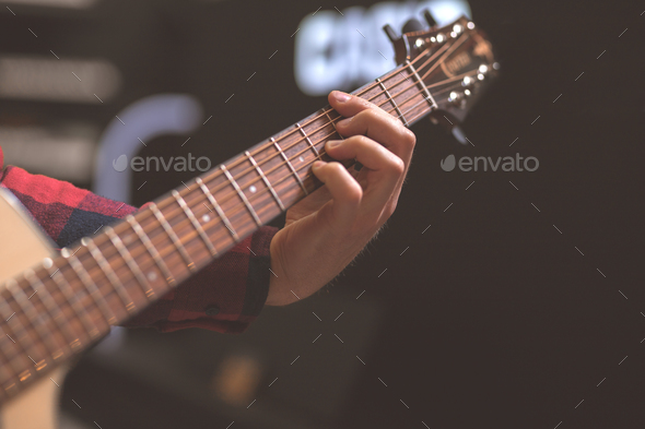 Musician playing the guitar - Stock Photo - Images