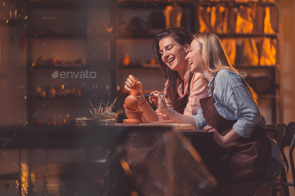 Smiling young women at work - Stock Photo - Images