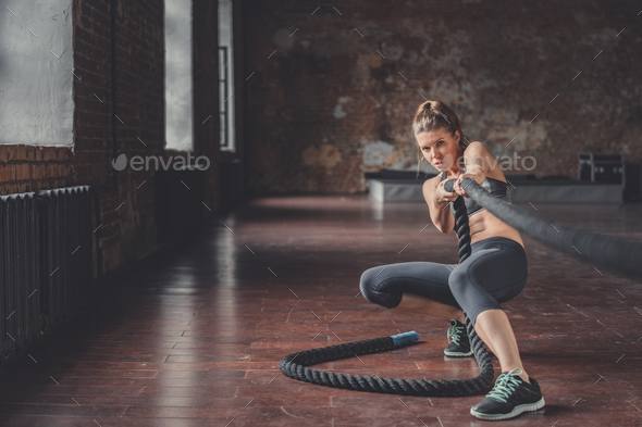 Young athletic girl with a rope - Stock Photo - Images