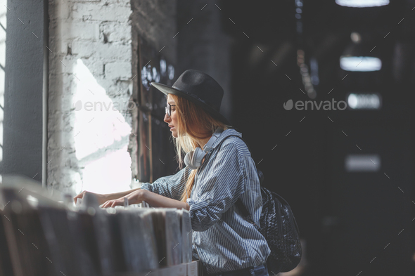 Young girl browsing records - Stock Photo - Images
