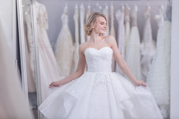 Attractive young girl in wedding dress - Stock Photo - Images