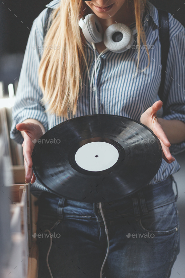 Young woman with music records - Stock Photo - Images