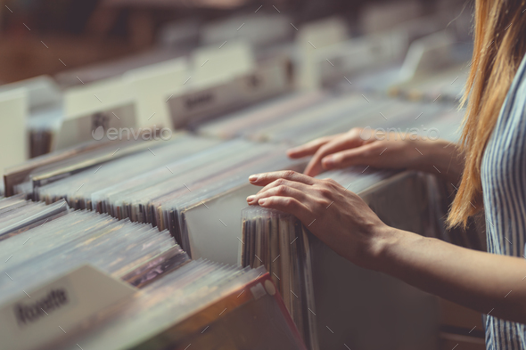 Young woman in a vinyl record store - Stock Photo - Images
