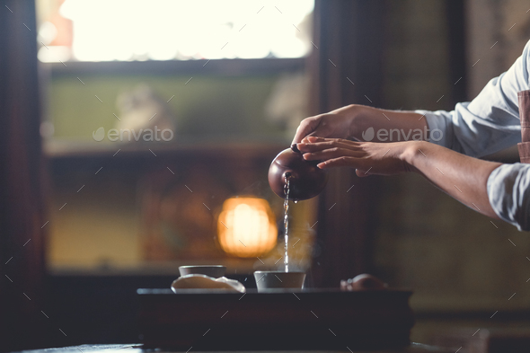 Women's hands pouring tea - Stock Photo - Images