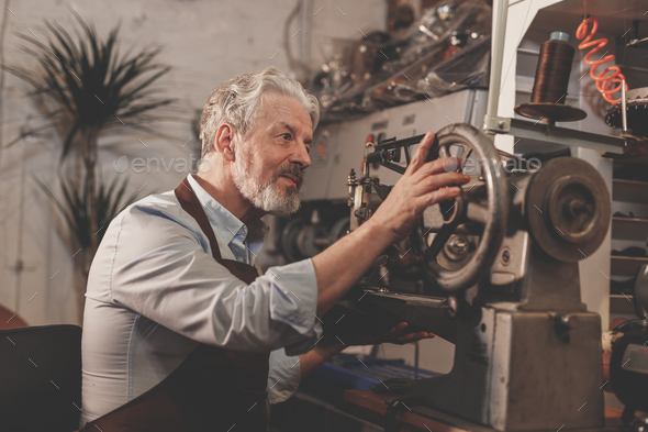Elderly man at the factory - Stock Photo - Images