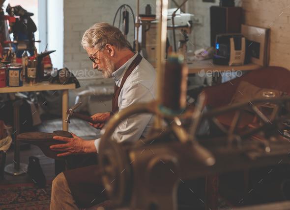 Elder cobbler at work - Stock Photo - Images
