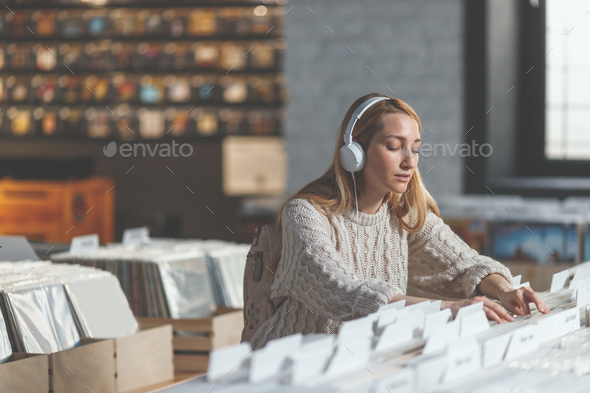 Attractive girl in a music store - Stock Photo - Images