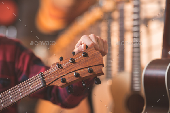 Musician with a guitar - Stock Photo - Images