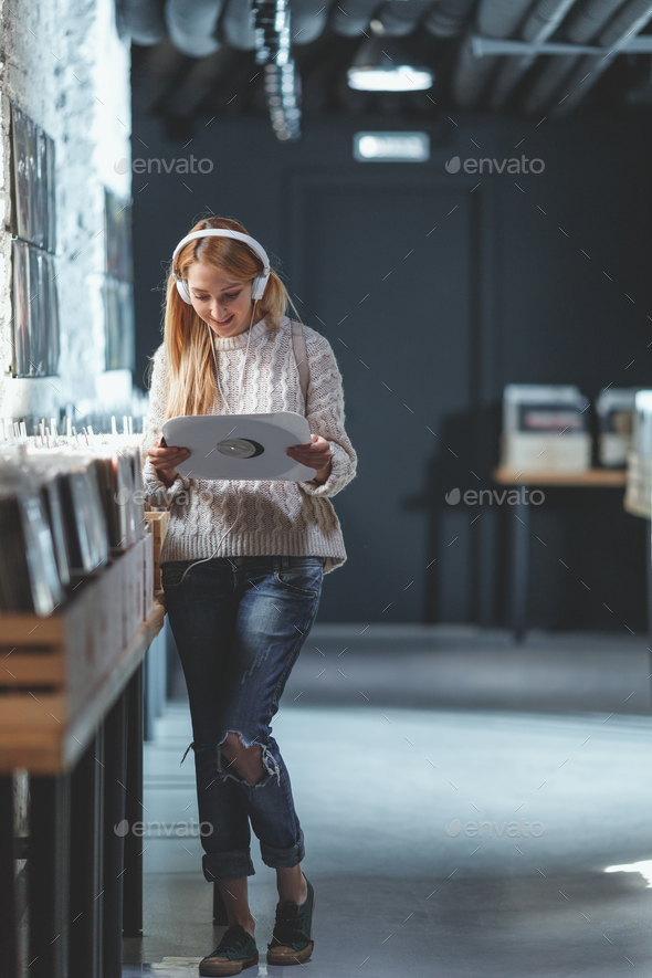 Young attractive girl in a music store - Stock Photo - Images