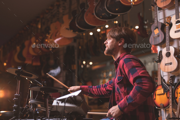 Young man playing the drums - Stock Photo - Images