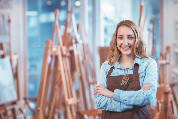 Young painter in uniform - Stock Photo - Images