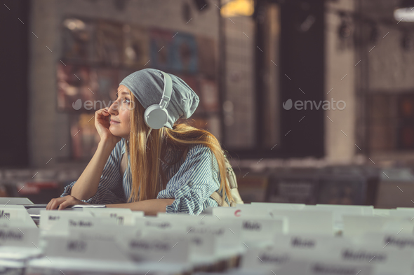 Dreaming girl in a music store - Stock Photo - Images