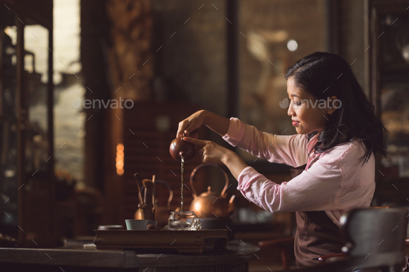 Young professional pouring tea - Stock Photo - Images