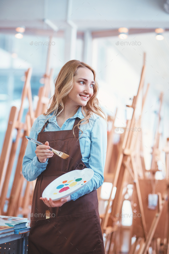 Young painter in uniform with easels - Stock Photo - Images