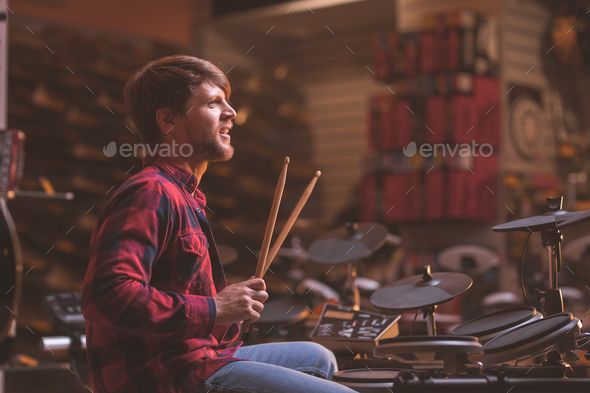 Young musician playing the drums - Stock Photo - Images