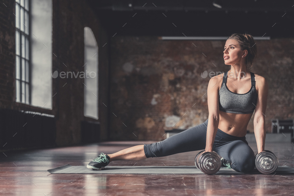 Young sporty girl with dumbbells - Stock Photo - Images