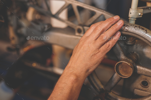 Man's hand in a factory machine - Stock Photo - Images