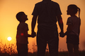 Father and children standing in the park at the sunset time. - PhotoDune Item for Sale