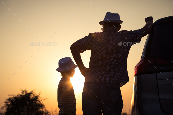 Father and son playing in the park at the sunset time. - Stock Photo - Images