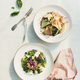 Fresh green summer salads in white plates, top view - PhotoDune Item for Sale