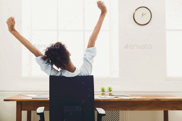 Business woman resting in office, back view - Stock Photo - Images