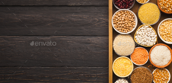Various gluter free groats on wooden background, copy space - Stock Photo - Images