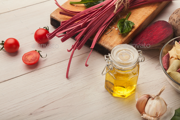 Colorful pasta and cooking ingredients on white wood - Stock Photo - Images