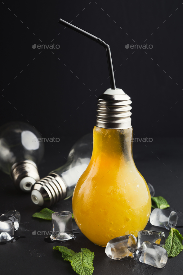 Cold cocktail in light bulb shaped glass on black background - Stock Photo - Images
