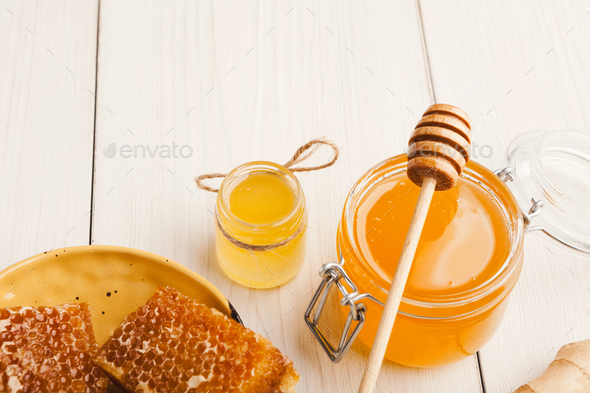 Various types of honey on white wooden background, closeup - Stock Photo - Images