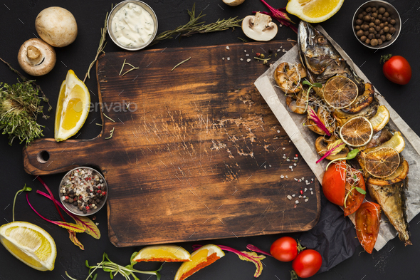 Grilled fish, cooking ingredients on wooden cutting board, top view - Stock Photo - Images