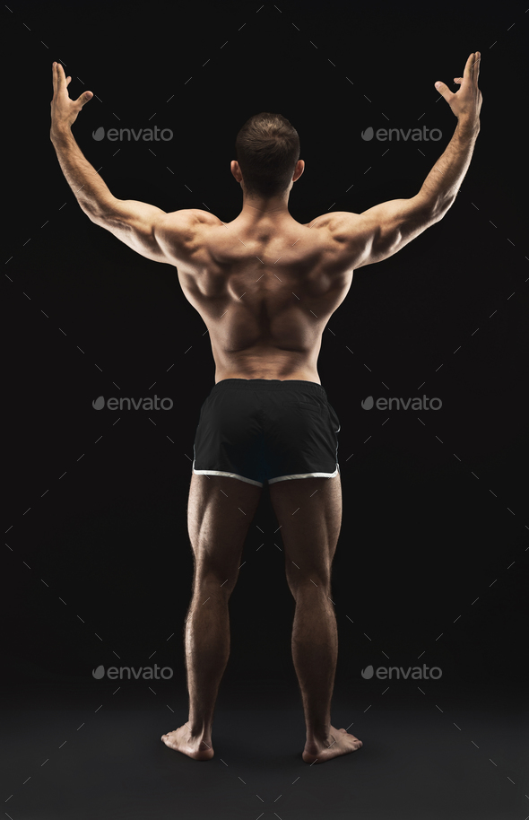 Unrecognizable man shows strong back muscles closeup - Stock Photo - Images