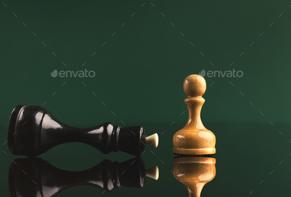 White pawn has got victory under black queen - Stock Photo - Images