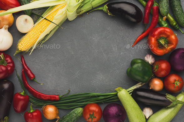 Frame of fresh vegetables on grey background with copy space - Stock Photo - Images