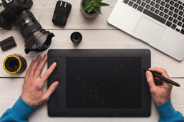 Designer hand working with graphic tablet - Stock Photo - Images