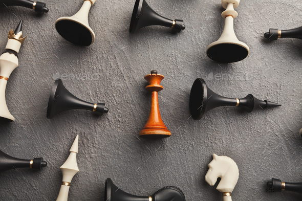 White queen lying among other chess - Stock Photo - Images