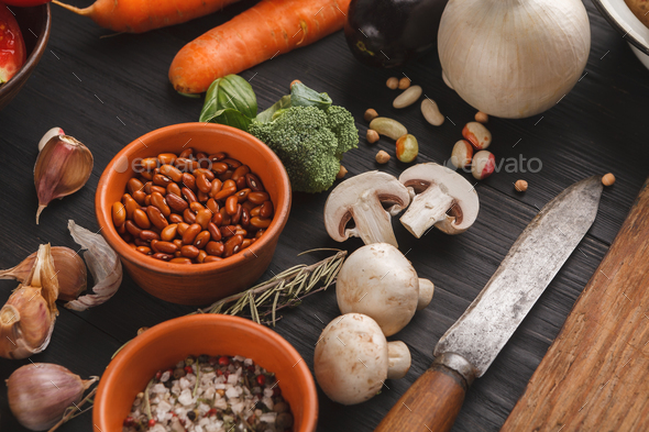 Fresh organic vegetables and wooden desk background - Stock Photo - Images