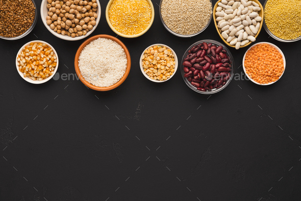 Various gluten free groats on black background with copy space - Stock Photo - Images