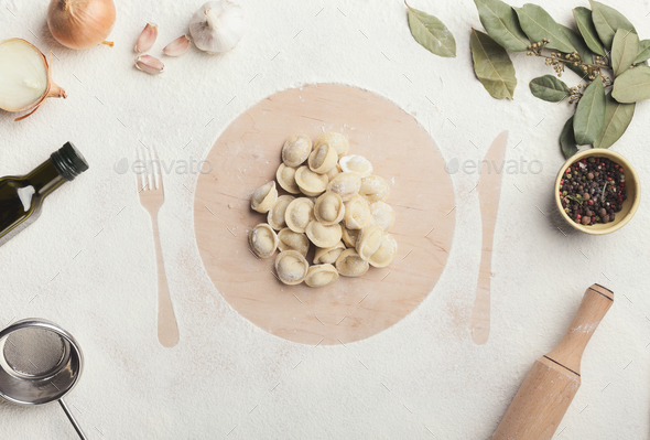 Dumplings on the table with flour, layout for recipe - Stock Photo - Images